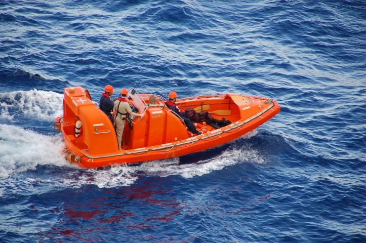 Ocean rescue team in bright orange boat