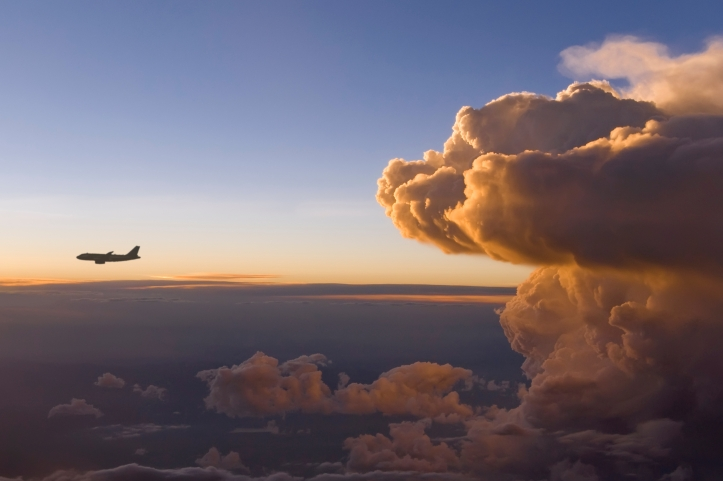 Top view of an airplane flying near a storm front